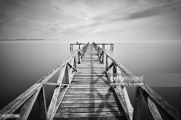 A wooden old jetty in black and white