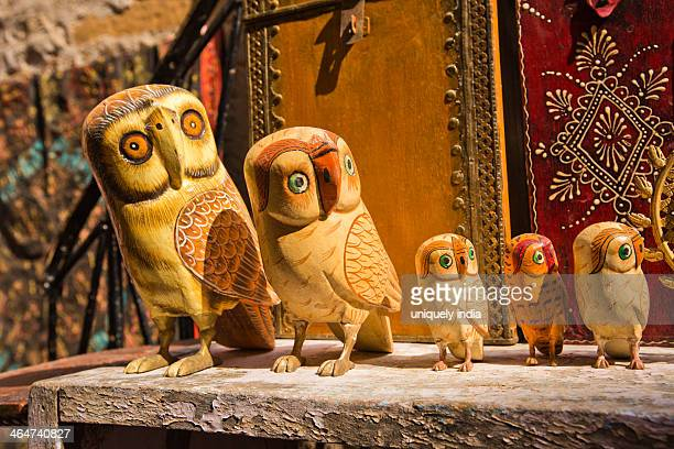 Wooden owl sculptures for sale at a market stall, Jaisalmer, Rajasthan, India