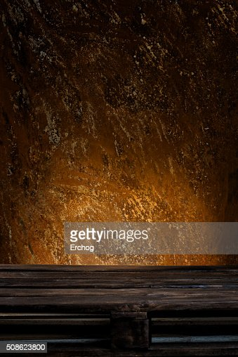 Wooden palette in front of rusty background : Stock Photo