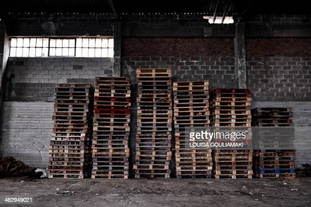 Wooden palettes are stacked against a wall at a closed cotton processing factory in Boeotia region in central Greece in this picture taken on...