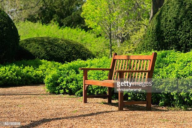 Wooden park bench in a formal garden space