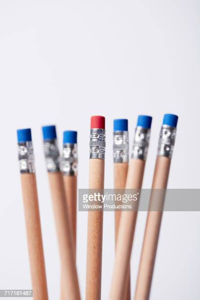 Wooden pencils, one with red eraser