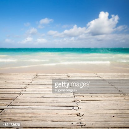 Wooden pier and blurred sea landscape on a background : Stock Photo