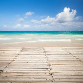 Square photo with empty wooden pier and blurred sea landscape on a background