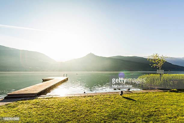 Wooden pier in still rural lake