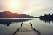 Wooden pier lying on lake Kaniere, South Island, New Zealand.