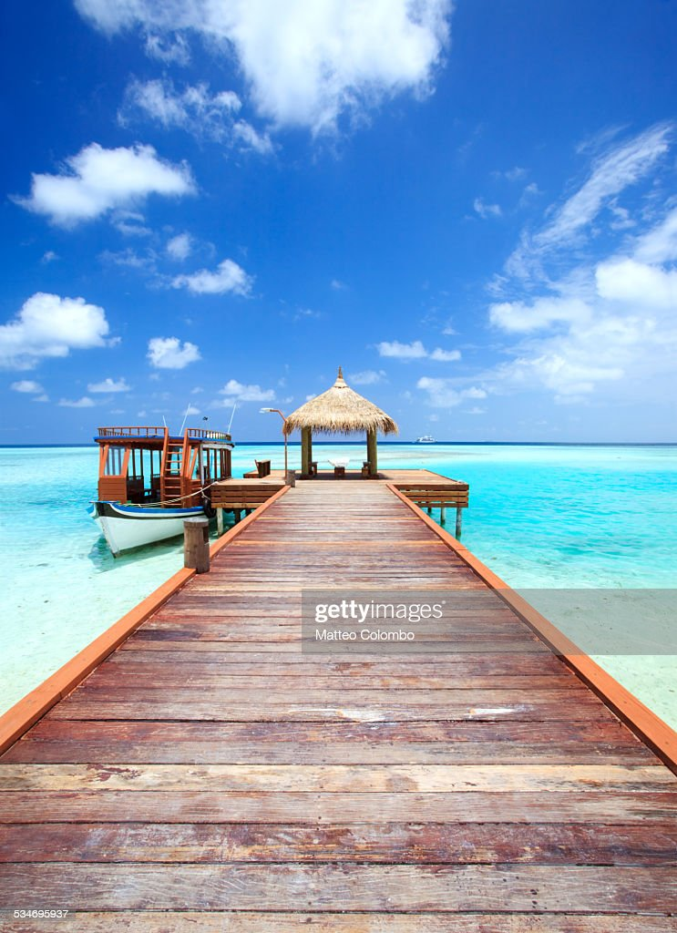 Wooden pier to lagoon, indian ocean, Maldives
