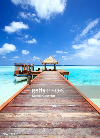 Wooden pier to lagoon, indian ocean, Maldives