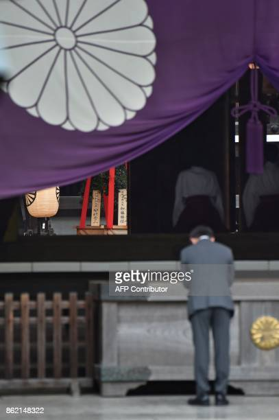 A wooden plaque showing the name of Japanese Prime Minister Shinzo Abe is seen with a 'masakaki' tree that he sent as an offering to the...