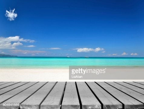 Wooden platform beside tropical white sandy beach : Stock Photo