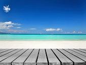 Wooden platform beside tropical white sandy beach