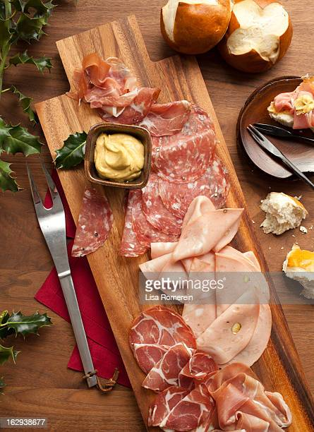Wooden platter with sliced deli meats