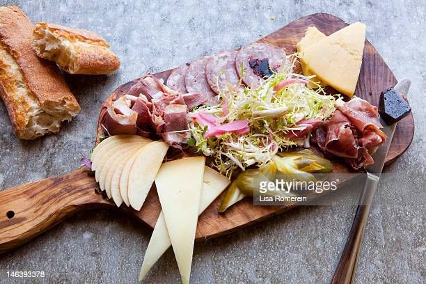 Wooden platter-sausage, cheese, bread & frisee