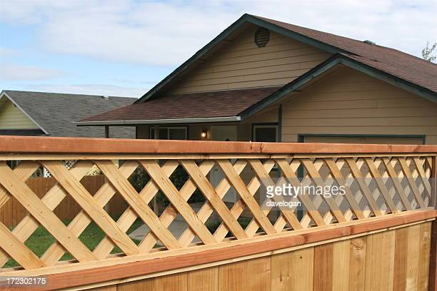Wooden privacy fence with diagonal trellis detail