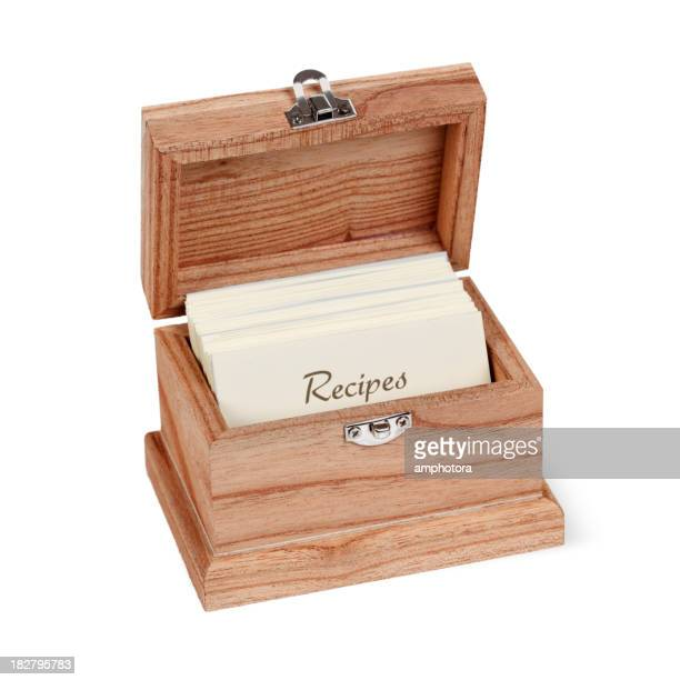 A wooden recipe box filled with recipe cards