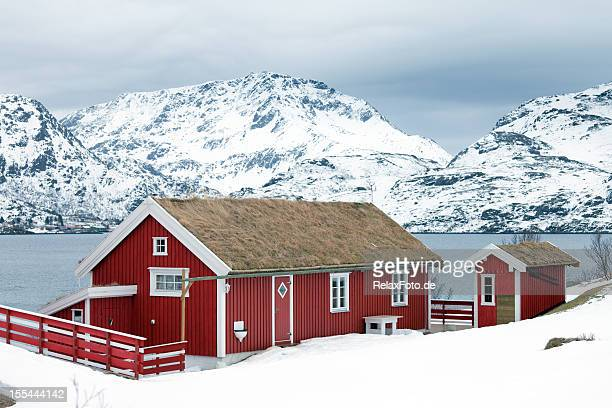 Wooden red home (rorbu) in winter on Lofoten Islands, Norway