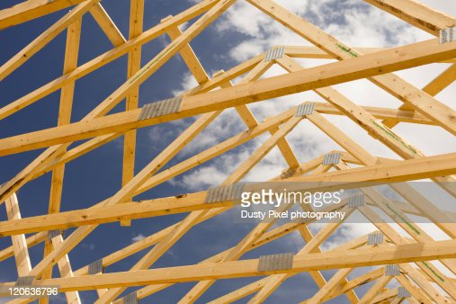 Wooden roof trusses stock photo getty images for Roof truss sign