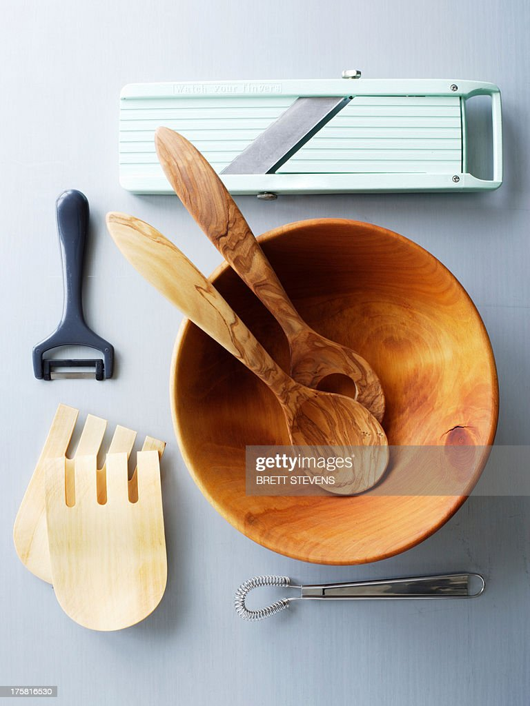 Wooden salad bowl and kitchen utensils : Stock Photo