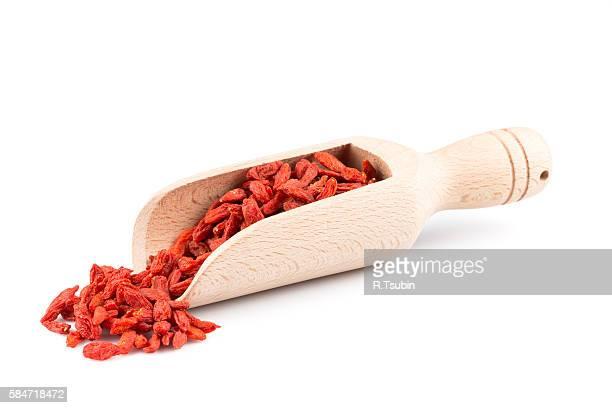 wooden scoop with goji berries