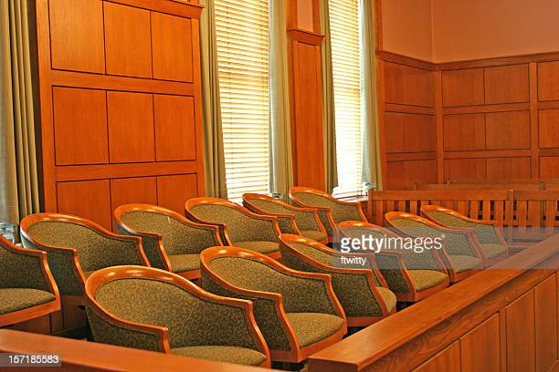 Wooden seated jury area of a clean court room