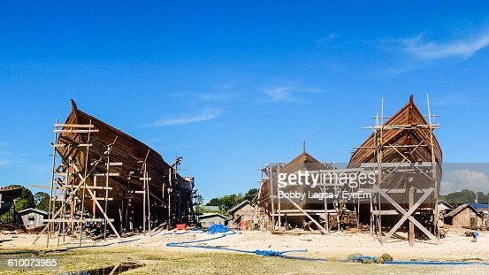Wooden Ship Frames At Shipyard Against Sky On Sunny Day