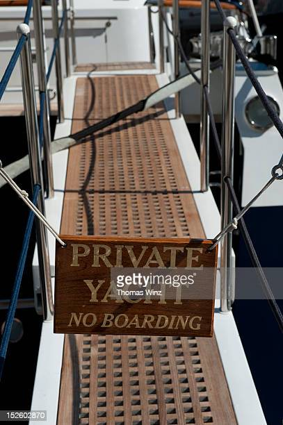 Wooden sign at private yacht