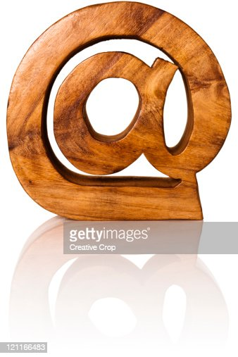 Wooden @ sign : Stock-Foto