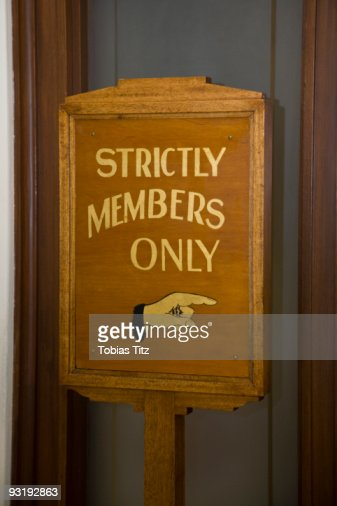 Wooden sign stating STRICTLY MEMBERS ONLY
