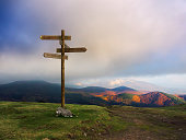 wooden signpost on the mountain