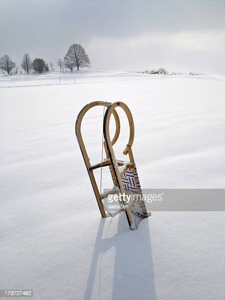 Wooden sledge in snow