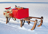 Wooden sledge with Christmas presents