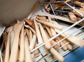 Wooden spatulas on shelf in utensil store