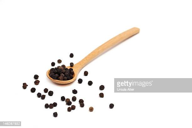 wooden spoon with black pepper