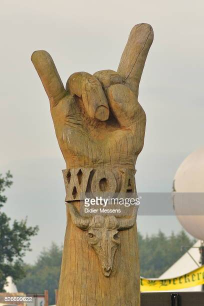 A wooden statue in the form of the sign of the horns which is the welcome sign for all visitors is seen during the Wacken Open Air festival on August...