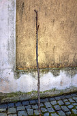 Wooden stick leaning on an old wall