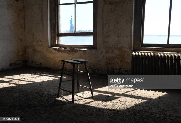 A wooden stool stands inside a room in one of the buildings of the The Ellis Island Hospital on August 5 a 750bed facility which treated over 12...