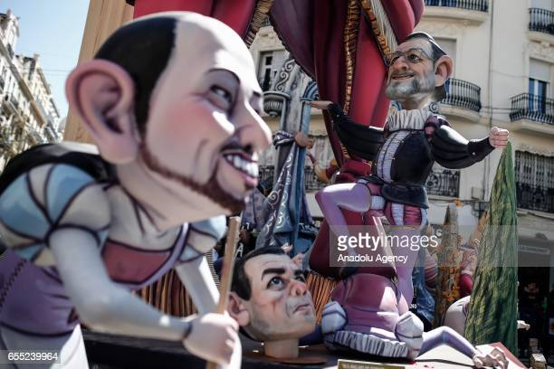Wooden structures made by carpenters and artists are displaced during Las Fallas festival in Valencia Spain on March 19 2017
