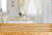 Empty wooden table and blurred dining room interior decoration background. Product display.