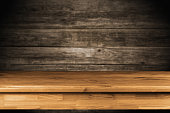 Wooden table on dark background