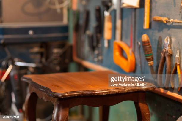 Wooden Table By Work Tools At Workshop