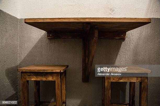 A wooden table mounted to the wall and two wooden chairs are seen in the hostel on the territory of the Prison Castle in Tobolsk Russia on 20 January...