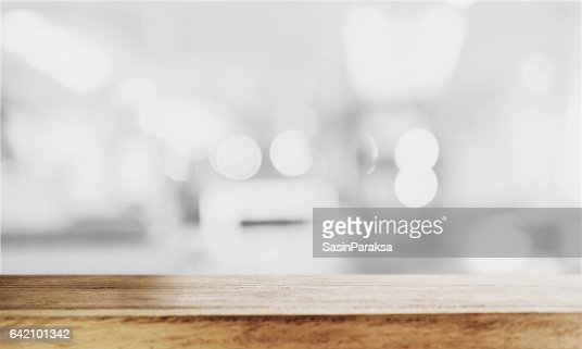 Wooden table top with Bokeh defocus backgrounds : Stock Photo