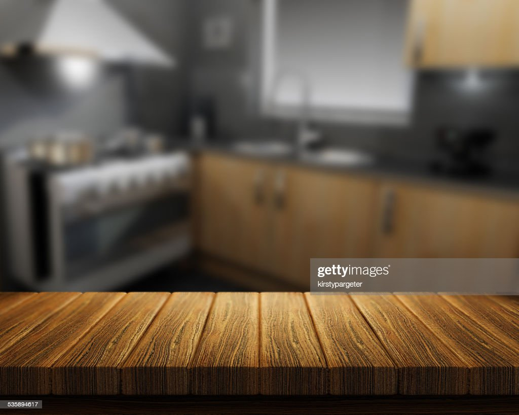 Wooden table with kitchen in background : Stockfoto