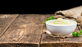 Portion of homemade Mashed Potatoes on wooden background (selective focus; close-up shot)