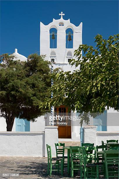 Wooden taverna chairs in front of the the church of Agios Konstantinos; Artemonas, Sifnos, Cyclades, Greek Islands, Greece
