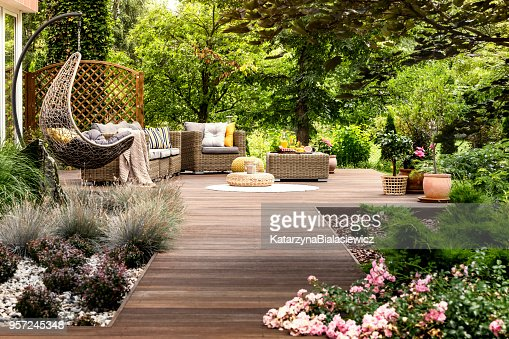 Wooden terrace surrounded by greenery : Stock Photo