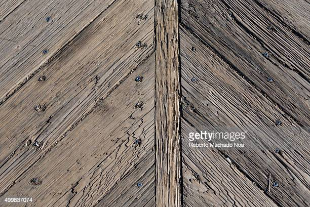 Wooden texture detail of New York cruise dock Full frame shot of wooden planks joined to form a structure at NY cruise dock Tourists have a variety...