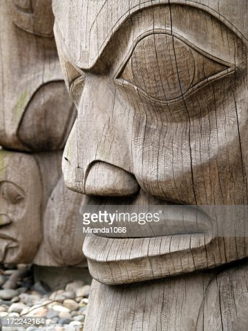 Wooden totem on pebbles