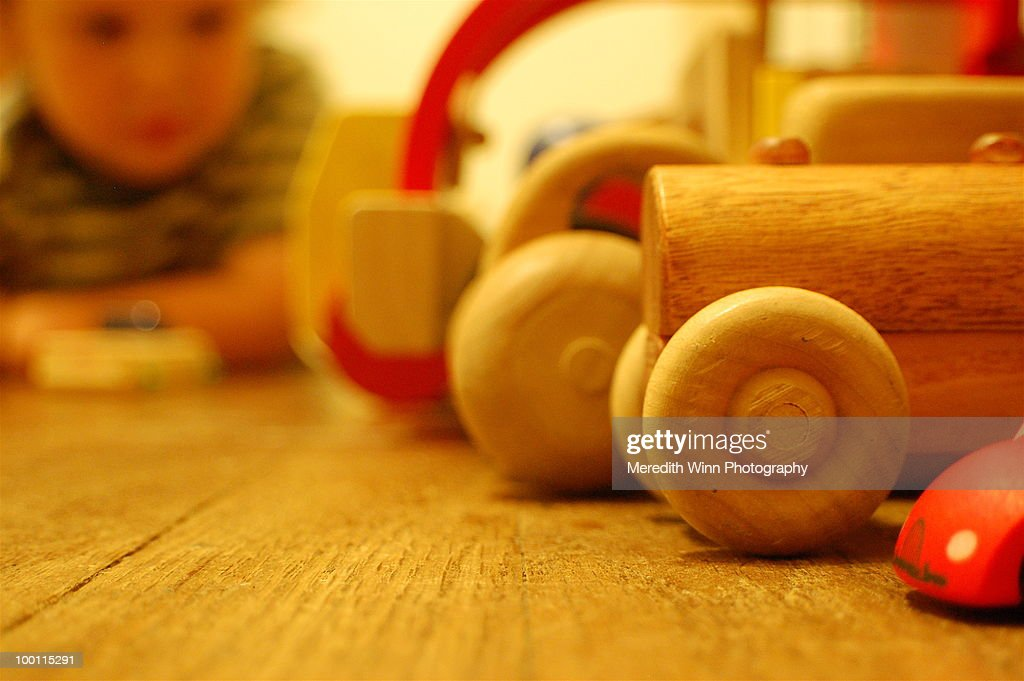 Wooden toy cars all lined up on the floor : Stock Photo