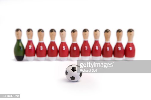 A wooden toy football team with a football. : Stock Photo